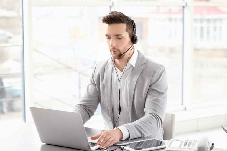 Handsome_young_man_working_in_office