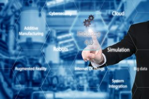 Business_man_touching_industry_4.0_icon_in_virtual_interface_screen_showing_data_of_smart_factory._Business_industry_4.0_concept.
