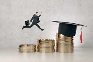 Side_view_of_young_businessman_running_on_abstract_golden_coins_with_mortarboard_on_concrete_background._Graduation,_knowledge_and_success_concept._3D_Rendering_